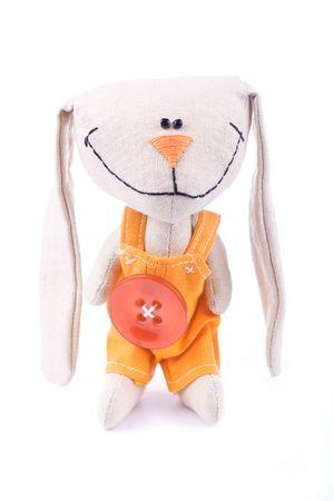 romper: Smiling fabric hare toy in romper suit