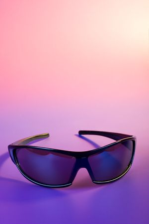 Sunglasses closeup on color background. Copyspace added  photo