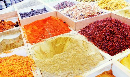 spices and herbs, Multicolored spices in a wooden organizer, top view. Seasoning background
