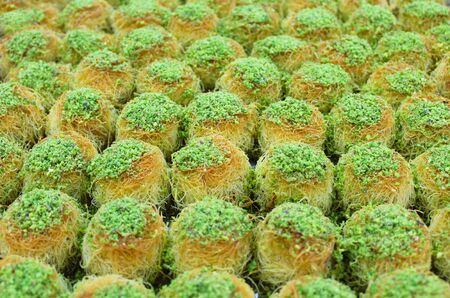 Traditional Turkish baklava served with pistachio. background 写真素材