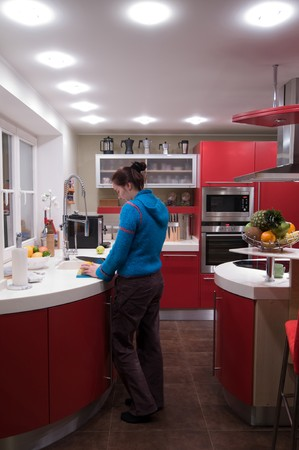 Red modern kitchen. Interiors. Cupboard. Table top. Stock Photo - 4352083