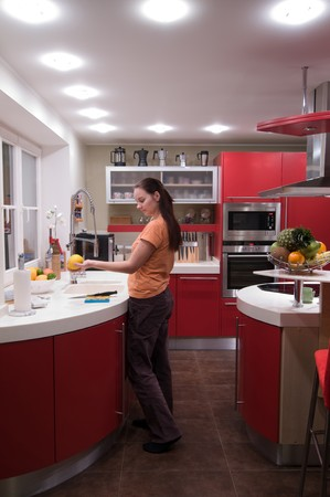 Red modern kitchen. Interiors. Cupboard. Table top. Stock Photo - 4352128
