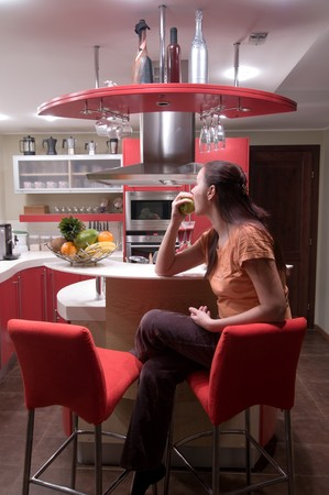 Red modern kitchen. Interiors. Cupboard. Table top. Stock Photo - 4352150