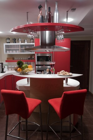 Red modern kitchen. Interiors. Cupboard. Table top. Stock Photo - 4349684