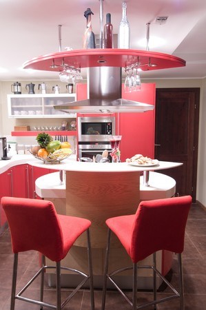 Red modern kitchen. Inters. Cupboard. Table top. Stock Photo - 4352127