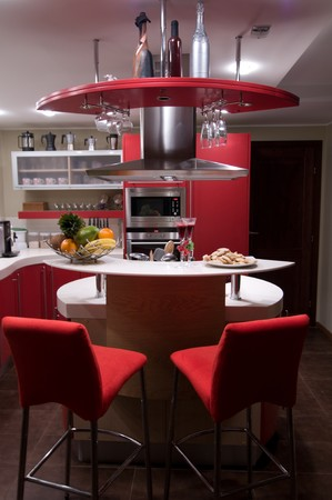 coffeepots: Red modern kitchen. Interiors. Cupboard. Table top.