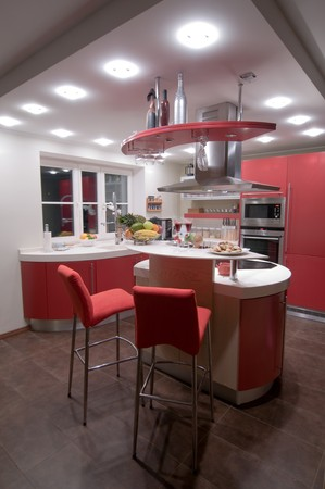 Red modern kitchen. Interiors. Cupboard. Table top.