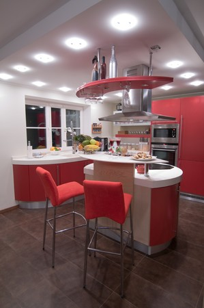 Red modern kitchen. Interiors. Cupboard. Table top. photo