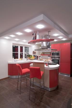 designers interior: Red cucina moderna. Interiors. Armadio. La tabella in alto. Archivio Fotografico
