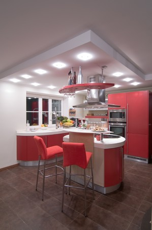 Red modern kitchen. Interiors. Cupboard. Table top. Stock Photo - 4352126