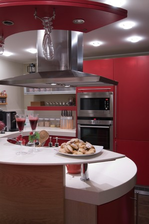 modern interiors: Red modern kitchen. Interiors. Cupboard. Table top.