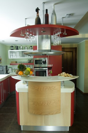 Red modern kitchen. Interiors. Cupboard. Table top. Stock Photo - 4354318
