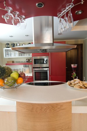 Red modern kitchen. Interiors. Cupboard. Table top. Stock Photo - 4352151
