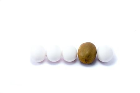 Eggs and kiwi on the white bakground photo