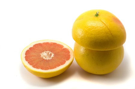 lifestile: Cuted frsh grapefruits on the white background Stock Photo