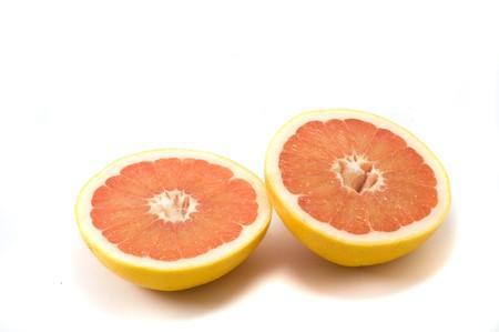 vitamines: Two fresh grapefruts on the white background