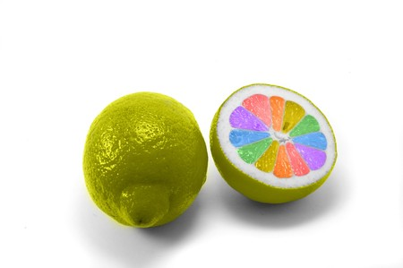 Fresh lemon painted to rainbow color on wite background