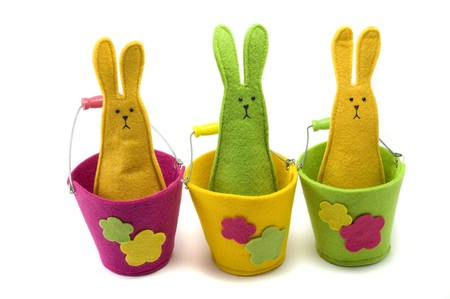 Easter bunnies sitting on the white background Stock Photo