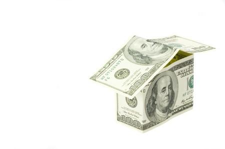 Dollars house on the white background photo