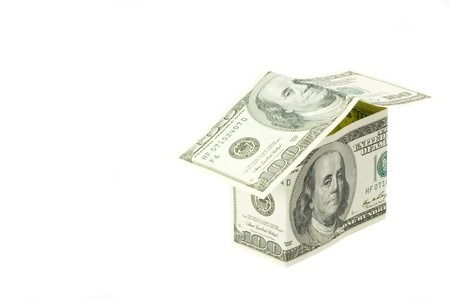 Dollars house on the white background photo