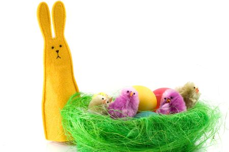 This image shows a basket full of colorful Easter eggs. photo