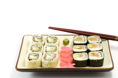 A selection of rolls sushi against a white background