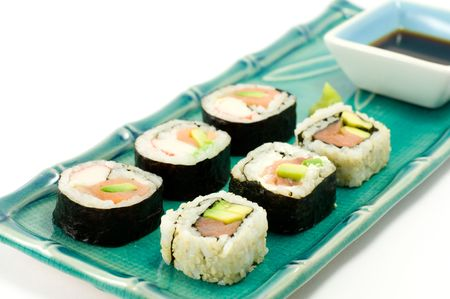 A selection of rolls sushi against a white background photo