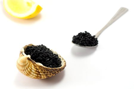 Shot of caviar isolated on white background