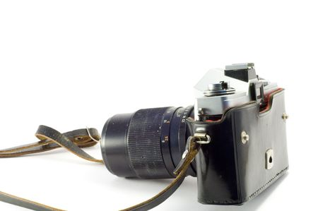 Retro photocamera in a leather case. Object over white