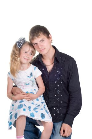 Older brother and younger sister in studio Stock Photo