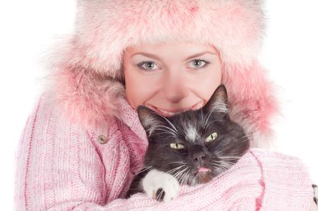 Woman in pink with black cat in studio photo