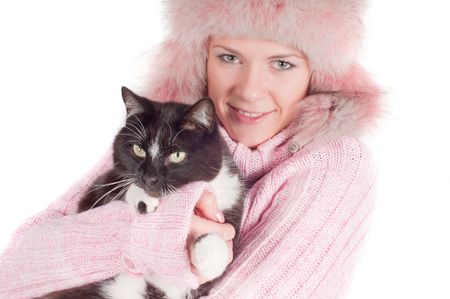 Beautiful woman in pink fur hat, isolated on white photo