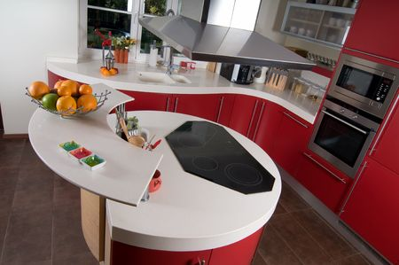 home renovations: Shot of beautiful red modern kitchen, interior