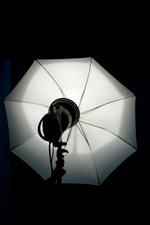 human photography: Shot of studio equipment - white umbrella, lighting Stock Photo