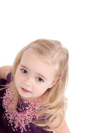 Studio shot of baby girl in lilac gala dress photo