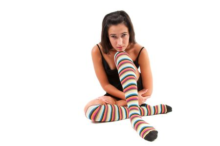 Shot of woman in multicolored stockings sitting onthe floor Stock Photo - 6192450