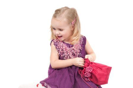 Studio shot of baby girl in lilac gala dress Stock Photo - 6244670