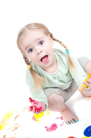 messy kids: Studio shot of little girl playing with colors Stock Photo