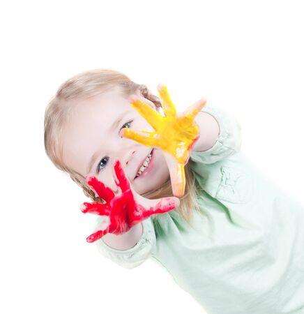 Studio grenaille de petite fille jouer avec les couleurs Banque d'images