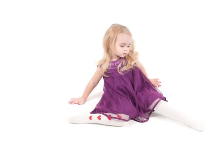 Studio shot of baby girl in lilac gala dress Stock Photo - 6944769