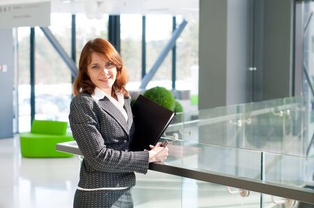 Shot of beautiful business woman in interior Stock Photo
