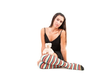 Shot of woman in multicolored stockings sitting onthe floor photo