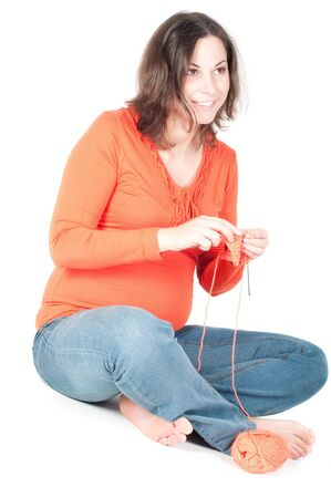Portrait of pretty pregnant woman knitting Stock Photo
