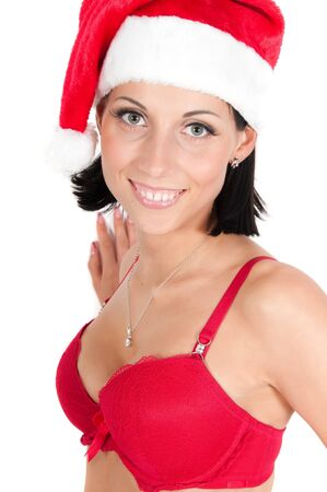Portrait of beautiful woman in red santa hat photo