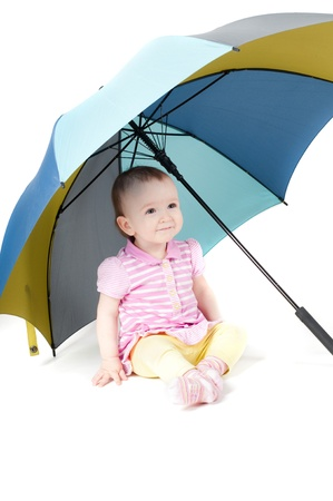 Cute baby girl under umbrella Stock Photo