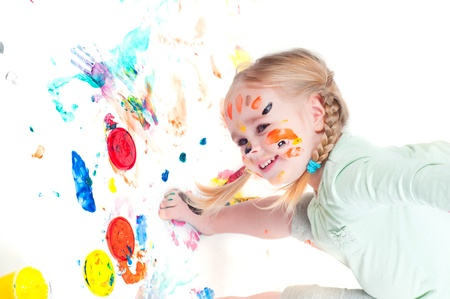 Little girl playing with colors Stock Photo - 9221856