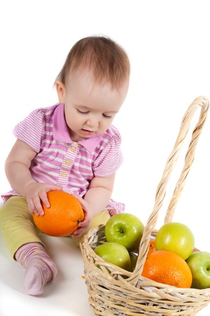 Baby girl in pink and fruits photo