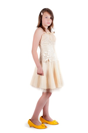 Teenager girl in mother's dress and shoes