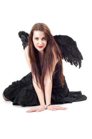 Beautiful brunette woman with black wings photo
