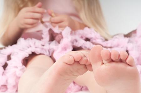 Toes of little girl in studio photo